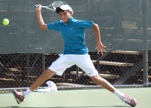 Parikh captures singles and doubles titles